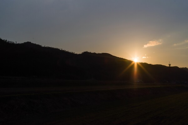 夕日の光芒。