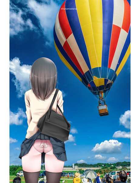 熱気球を見るJK